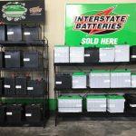 Battery racks containingt Intertate brand car and truck batteries.